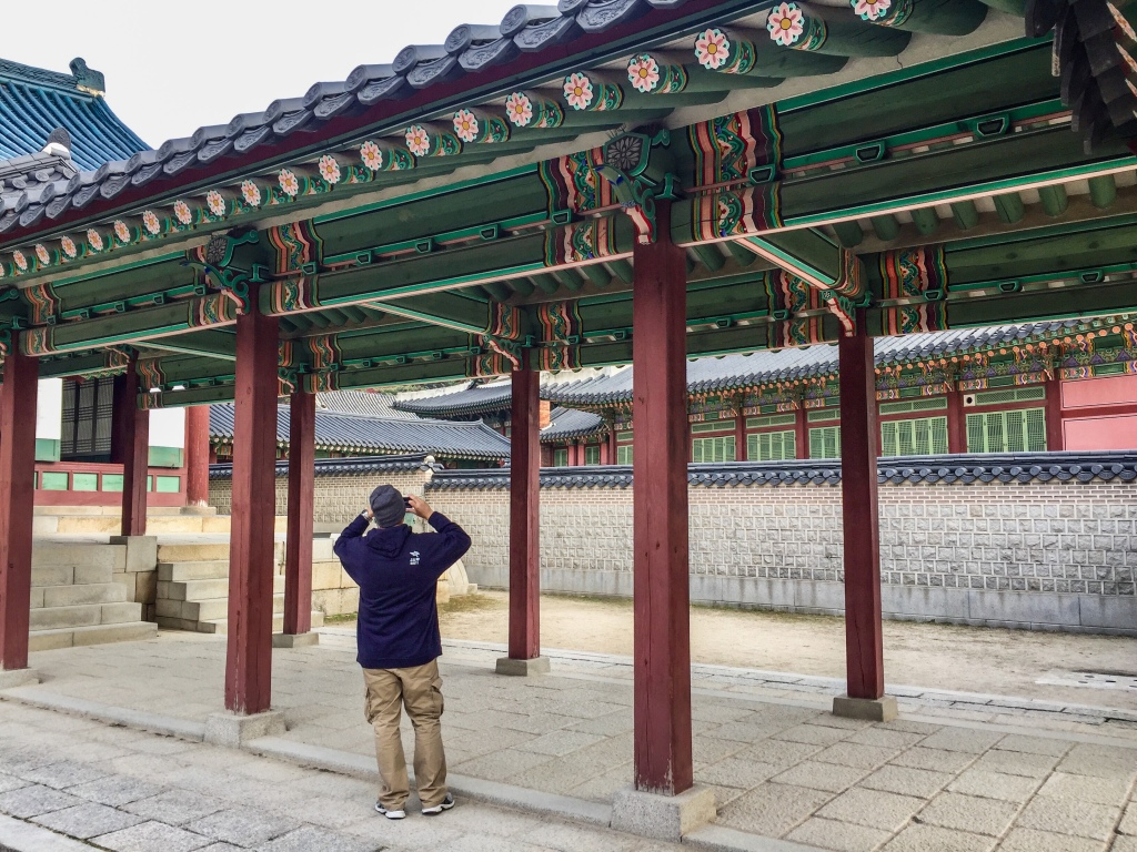 Another tourist taking a photo in a palace in Seoul, South Korea